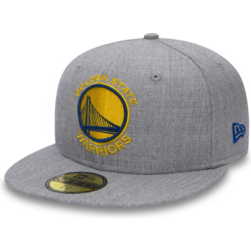 ... State Warriors NBA de New Era. gorra -plana-gris-ajustada-59fifty-heather-de-golden- 8e4b550bb4d